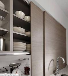 Love how the shelving is hidden behind the sink, and extra counter space at bottom for easy access storage all round.