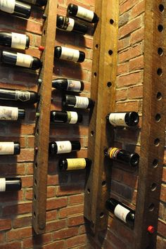 Exposed brick and wood looks suitably rustic, and pre-drilled holes provides a great storage solution for wine bottles.