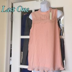 🌷Sale🌷LC Lauren Conrad Rose  Pleated Top Color : Antique Rose. Size : Large . Blouse is a rose color, but looks peachy. Soft and pretty. 100% polyester. Blouse front has lace yoke with pleats. One button on the back neck for closure. Brand new with tags. LC Lauren Conrad Tops Blouses