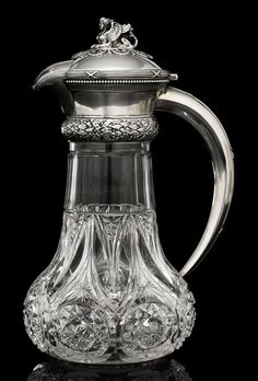 A SILVER-MOUNTED CUT-GLASS JUG - MARKED LORIE, WITH THE MAKER'S MARK OF EGOR CHERYATOV, ST PETERSBURG, 1908-1917.