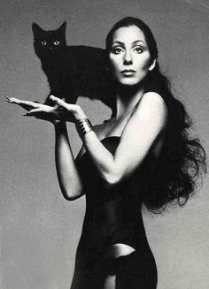 Cher with a feline friend.