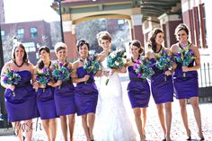 Peacock feathers and jewel tones made these wedding photos pop and no one can tell that the flowers aren't real!