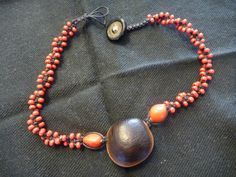 "Deer eye ""sea bean"" used as a focal point bead with glass beads in a macrame necklace, choker. Mamaw Mom's Treasures"