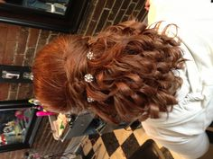 Curled half updo with  French braid  prom hair