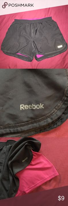 Reebok workout shorts Dark grey and pink. Sewn in shorts (similar to Nike pro combat) small hole pictured next to logo. Reebok Other