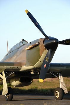 A Hawker Hurricane parked on the apron in the earaly morning light.