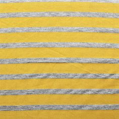 Small Heather Gray and Mustard Yellow Stripe Cotton Jersey Blend Knit Fabric - A pretty mustard yellow stripe and heather gray small stripe on cotton jersey poly rayon blend knit.  Fabric is soft with a nice drape and stretch, light to mid weight.  Heather gray stripe measure 1/2