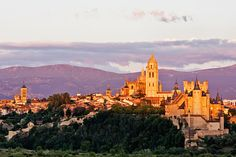 The last rays of the sun paint Segovia's spectacular monuments with warm orange light. Photo ©Mike Randolph