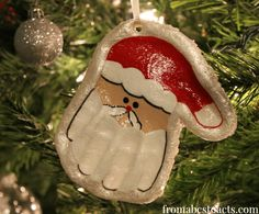 Christmas ornament crafts:  Lots of handmade ornaments on this site.  LOVE the salt dough Santa hand print ornament.  Definitely making this one with my grandchildren. Since salt dough is easy and relatively inexpensive, this would be a nice keepsake gift for your students to make too.
