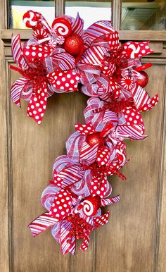 Your place to buy and sell all things handmade Candy Cane Door Hanger Candy Cane Wreath Candy Cane Decor image 9 Large Christmas Wreath, Diy Christmas Decorations For Home, Christmas Crafts, Christmas Ornaments, White Christmas, Red Ornaments, Christmas Ideas, Deco Mesh Christmas Wreaths Diy, Peppermint Christmas Decorations