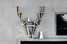 Geometric-Deer-Head-Bookshelf-Design by BeDesign Bookshelf Styling, Bookshelf Design, Bookshelf Ideas, Deer Wood, Geometric Deer, Geometric Drawing, Creative Bookshelves, Minimalist Scandinavian, Scandinavian Style