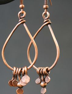 Copper Teardrop Earrings Copper Earrings Kind of remind me of paisley earrings Just over 2.25 inch (57mm) long chandelier drop shaped earrings 1.25 inches (32mm) wide Handmade ear wire, antiqued patina, and hand buffed. Thank You for Shopping with Twisted by Design Wire Wrapped