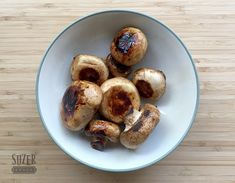 Button mushrooms get a boost of flavor when grilled at high heat with a splash of balsamic vinegar.