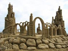 sandcastle. seriously, how??!//thinking the very same thing!!  Gotta find a local where they're doing this so I can see them go up. Until then not sure I believe all these photo's.