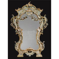 A fine and rare Italian carved and polychrome painted mirror Genoese, mid 18th century the reverse of the frame with some further painted decoration