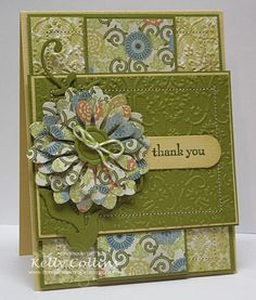 card by Kelly Collins...love that the flower matches the patterned center panel.... and all the embossing