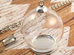 ~ Lovely SIlver DIY Glass Globe Necklace Kit ~  ~ Material: Glass top and metal base ~ Size: 30mm diameter globe, 20mm diameter base opening ~ Color: Silver ~ Quantity: 1 base, 1 glass globe, 1 silver cap with loop, 1 silver chain loop connector, and 1 silver antique style chain ~Chain: 74cm (29) *************************************************************  To View Other Designs & Vintage Style Jewelry Click Here: http://www.etsy.com/shop/KaysvilleCraftSupply?section_id=14009454  To View My…
