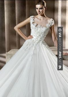 """So cool - 5. Elie by Elie Saab """"Neftis"""" White Ballgown with Full Organza Skirt and Floral Bodice Detailing    A blend of some of the industry's most sumptuous fabrics – silk taffeta, embroidered lace and silk organza -Neftis isthe ideal gown for a… 