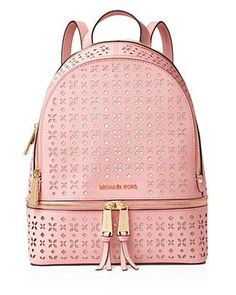 Floral-patterned perforating brings a breath of fresh air to Michael Michael Kors supple leather backpack, the new city carryall. | Leather | Imported | Top handle, adjustable backpack straps | Zip