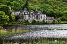 """Kylemore Abbey, Connemara, Ireland  This was a beautiful place to visit.  To remember my visit, I purchased a pitcher handcrafted by the Benedictine nuns. The design was inspired by the fuchsia flower known in Gaelic as """"Deora De-Tears of God""""."""