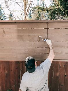 How to stain a DIY horizontal cedar privacy fence the fast & easy way in under a few hours with a paint sprayer and roller brush. The color is Behr semi-transparent in Tugboat. - Rain and Pine