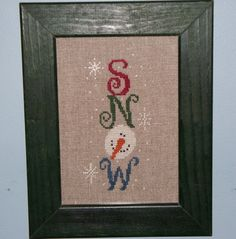 Cross stitch sampler with Snow and Snowman.