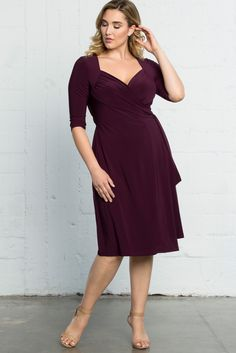 Don't be afraid of adding color to your wardrobe. Our plus size Sweetheart Knit Wrap Dress comes in this eye-catching plum that is great for any occasion and season. A sweetheart neckline and 3/4 length sleeves add a classic touch to your look. This is one timeless style you'll never get tired of. Made exclusively for women's plus sizes. Made in the USA. Shop our entire collection of plus size wrap dresses at www.kiyonna.com.