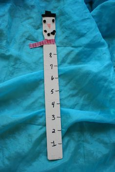 Re-Cycled Paint Stick Snowman Snow Ruler! A fun art, science and mesaurement project. Could also be a literacy project if a journal is kept comparing the snow fall/melt per day or week.