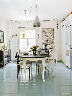 love this colour of flooring for the kitchen -- with white cabinets, butcher block counters, silver hardware & white walls