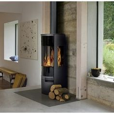 AGA Dorrington Wood burning Stove available from authorised AGA Stove retailer. Call to Buy AGA Dorrington Stove at best price or Buy stove online today Modern Wood Burning Stoves, Aga Stove, Beech Grove, Wood Fuel, Heat Resistant Gloves, Wood Paneling, House Ideas, Contemporary, Living Room