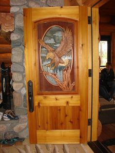 Landing Eagle DoorCedar/Pine door & jamb with carved eagle (both sides) and etched glass.  Cost: $6,980