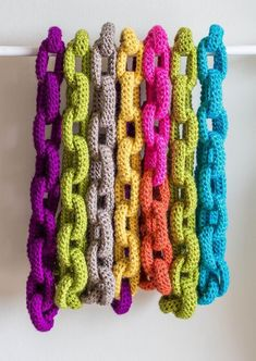 By popular demand, it's the pattern for your favorite crochet bling! I've refined the size and shape of these links to make the perfect crafty swagger statement.This is a perfect beginner's pattern, using only slip stitches and single crochet, with no special skills. Each scarf takes about 3-4 hours, so you can finish it in a single evening.You can use about 450 yds of worsted weight yarn, or about 225 yds of bulky or super bulky weight yarn.Scale the length for a scarf that wraps around…