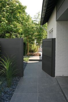 love the dark fence, lighter stone (and of course, bright greenery)