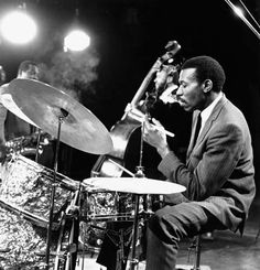 Elvin Jones. Considered the most influential jazz drummer of the 1960s by virtue of his work with John Coltrane, Jones expanded the bebop drumming vocabulary through an aggressive approach that featured multiple levels of rhythm based on a rolling-triplet pulse.