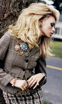 A bunch of vintage brooches on a tweed jacket. Love it!