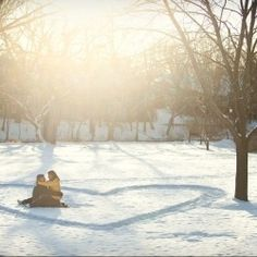 Heart of snow...would be a cute family pic. Could do at the beach too!♥