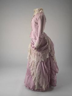"""Two piece pink full length wool dress (bodice and skirt) with cream lace trimming, 1883-1886. Printed label back waist of jacket """"David Jones & Company Sydney""""."""