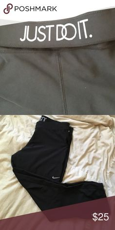 """Nike dri-fit cropped leggings. like new condition! these cropped Nikes have a reflective stripe for nighttime jogging and a fold over waistband with """"Just Do It"""" on the back! zipper pocket for keys Nike Pants Capris"""