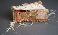 The Origin of Birds by Lisa Kokin. Book spine parts, thread, found text and images, 2.5 x 5.5 x 1 inches, 1999