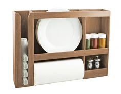 A SeaTeak dish/cup/spice/towel rack is storing plates, a paper towel roll, spices, and cups.
