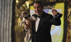 Jean Dujardin and co-star Uggie. 84th Academy Awards. Oscars.