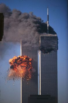 The second tower of the World Trade Center bursts into flames after being hit by a hijacked airplane 11 September 2001, Remembering September 11th, World Trade Center Attack, World Trade Center Site, Twin Towers Memorial, Nine Eleven, 911 Never Forget, City Photography, Stunning View