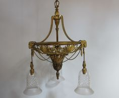 English three arm ceiling light of outstanding quality and in the original gilt brass finish, with rams' head and other Regency motifs.  www.antiquelightingcompany.com