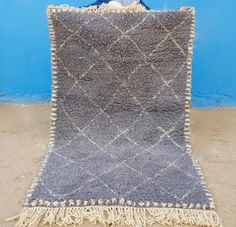 Beni Ourain rugs are handwoven by Berber women of the Beni Ourainl tribe in the Middle Atlas Mountains  Moroccan Berber rugs and textiles have tribal motifs that seem simplistic but are extremely rich and complex in  symbolism and they convey deep visual beauty and emotions