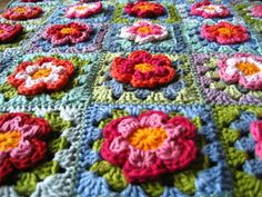 picture crocheted granny square blanket with flowers