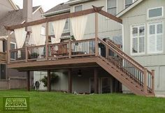 EverGrain Deck with Aluminum Under Deck Guttering System / Under Deck Ceiling and Cedar Arbor Rail in Overland Park, KS