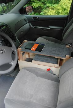 … Custom center console of Side view with writing surface in place. The writing surface can be installed only when the van is shifted into Park gear because of the position of the shift lever. Visible inside the console is the upper of Van Storage, Truck Storage, Camper Storage, Camping Box, Minivan Camping, Astuces Camping-car, Honda Element Camping, Diy Auto, Van Organization