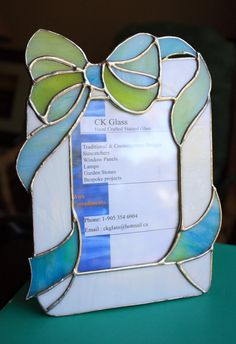 Items similar to Blue Green Bow Photo Frame on Etsy Stained Glass Frames, Stained Glass Ornaments, Stained Glass Suncatchers, Stained Glass Projects, Stained Glass Patterns, Stained Glass Art, Mosaic Glass, Light Bulb Crafts, Glass Picture Frames