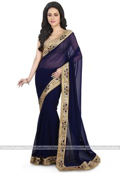 Faux Georgette Saree in Navy Blue Gracefully Enhanced with Resham, Sequins, Mirror Effect and Patch Border Work Available with an Semi-stitched Art Dupion Silk Blouse in Beige Free Services: Fall and Edging (Pico) Do Note: All Blouse and Accessories shown in image is for presentation purpose only. (Slight variation in actual color vs. image is possible. )