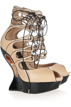 Lace-up leather wedge sandals by Alexander McQueen Originally $6195, now $2478 . It's almost like a work of art!!1